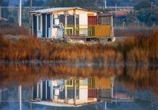 Reflexão da casa do nascer do sol Fotografia de Stock