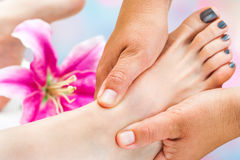 Reflexologist working on female foot Royalty Free Stock Image