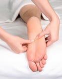 reflexology массажа ноги Стоковые Изображения