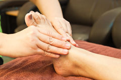 Reflexology foot massage Royalty Free Stock Photos