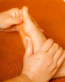 Reflexology foot massage Stock Photos