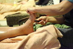 Reflexology foot massage, foot spa treatment Royalty Free Stock Images