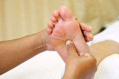 Reflexology foot massage, spa foot. Treatment for relax and release pain Stock Photos