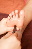 Reflexology foot massage, spa foot treatment Stock Photo