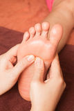 Reflexology foot massage, spa foot treatment Stock Photos