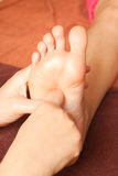 Reflexology foot massage, spa foot treatment Stock Images