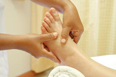 Reflexology foot massage, spa foot treatment Royalty Free Stock Photo