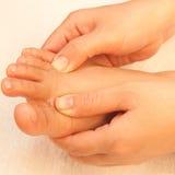Reflexology foot massage Royalty Free Stock Photography