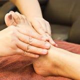 Reflexology foot massage Stock Image