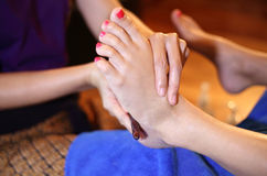 Reflexology foot massage, spa foot treatment by wood stick Stock Photography