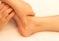 Reflexology foot massage, spa treatment Royalty Free Stock Image