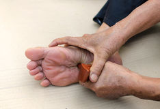reflexology foot massage, Spa treatment yourself Stock Photos