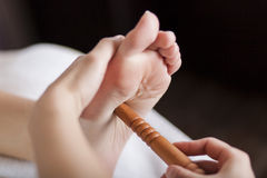 Reflexology foot massage Stock Image