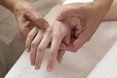 Reflexology on hands for joint relaxation Stock Photos
