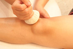 Reflexology knee massage by ball herbal Stock Photos
