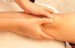 Reflexology knee massage, spa knee treatment Stock Image