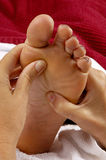 Reflexology Massage on Foot Royalty Free Stock Image