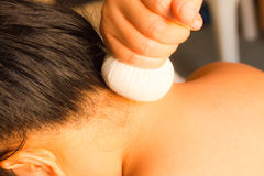 Reflexology neck massage. Spa the neck treatment by ball-herb,Thailand Stock Photo