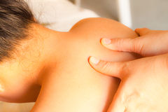 Reflexology shoulder massage Stock Photo