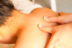 Reflexology shoulder massage. Spa the shoulder treatment,Thailand Stock Photo