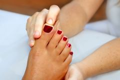 Reflexology woman feet massage therapy Stock Photos