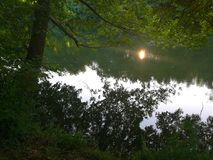 Reflexos no rio Imagem de Stock