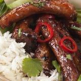 Reforços de carne de porco com arroz Fotos de Stock