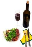 Reforços de carne de porco com batata e vinho Foto de Stock