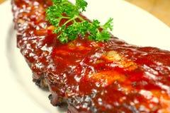 Reforços de carne de porco deliciosos smothered Foto de Stock Royalty Free