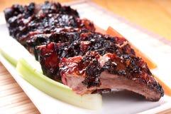 Reforços de carne de porco do BBQ Fotografia de Stock