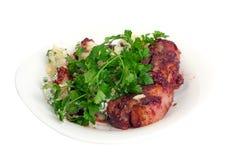 Reforços de carne de porco no molho de airela Imagem de Stock