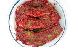 Reforços de carne de porco no molho de airela Imagens de Stock