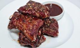 Reforços de carne de porco picantes Fotos de Stock