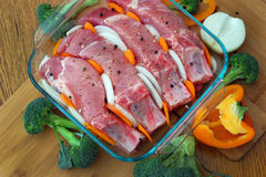 Reforços de carne de porco preparados cozinhando Imagens de Stock
