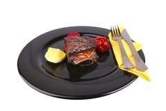 Reforços no prato preto Foto de Stock