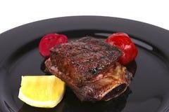 Reforços no prato preto Fotos de Stock