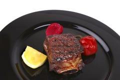 Reforços no prato preto Imagem de Stock Royalty Free