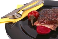 Reforços no prato preto Imagem de Stock