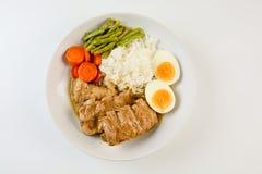 Refor?os de carne de porco cozidos com arroz fotografia de stock royalty free