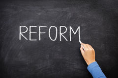 Reform blackboard - education reform. Or other. Hand writing REFORM with chalk on black chalkboard Royalty Free Stock Photos