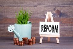 Reform, Business Concept. Miniature easel with small change.  Stock Images