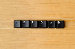 Reform word. With keyboard buttons Royalty Free Stock Images