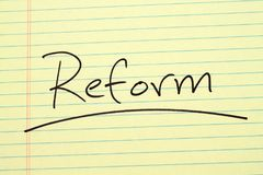Reform On A Yellow Legal Pad. The word `Reform` underlined on a yellow legal pad Royalty Free Stock Photo