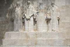 Reformation wall in Geneva. The four reformists commemorated on a wall in Parc Des Bastions in Geneva, Switzerland.  Depicted are William Farel, John Calvin Royalty Free Stock Photos