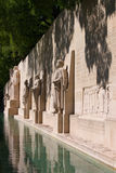 Reformation wall in Geneva. Statues on Reformation wall in Geneva with reflections in water, Vertical. Switzerland, EU Stock Photography