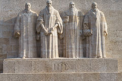 Reformation wall in Geneva. Statues on Reformation wall in Geneva, Switzerland. From left to right: William Farel, John Calvin, Theodore de Beze and John Knox Stock Image