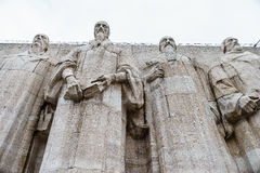 Reformation wall in Geneva. Statues on Reformation wall in Geneva, Switzerland. From left to right: William Farel, John Calvin, Theodore de Beze and John Knox Stock Images