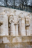 Reformation wall in Geneva. Statues on Reformation wall in Geneva, Switzerland. From left to right: William Farel, John Calvin, Theodore de Beze and John Knox Royalty Free Stock Photos