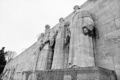 Reformation wall in Geneva. Statues on Reformation wall in Geneva, Switzerland. From left to right: William Farel, John Calvin, Theodore de Beze and John Knox Royalty Free Stock Image