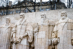 Reformation wall in Geneva. Statues on Reformation wall in Geneva, Switzerland. From left to right: William Farel, John Calvin, Theodore de Beze and John Knox Stock Photography
